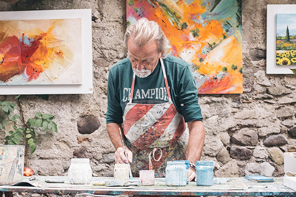 An image of an elderly person painting